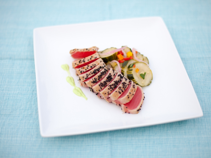 Steamers Catering Seared Yellow Fin Tuna on a cucumber salad and wasabi dressing.