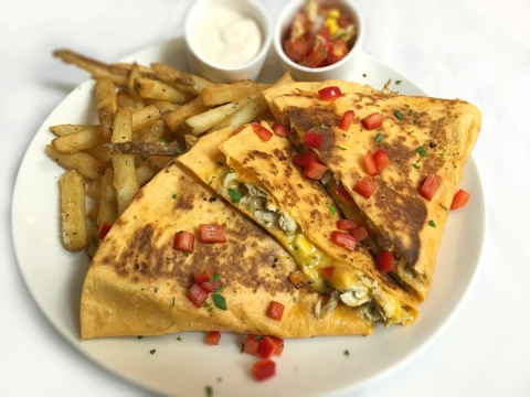 Our delicious Gulfstream fish Quesadilla is delicious fish, red pepper, onion sauté and sharp cheddar cheese served in a tomato wrap with fresh salsa & cilantro, and lime sour cream.
